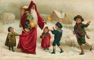 Св. Миколай пригощає дітей гостинцями